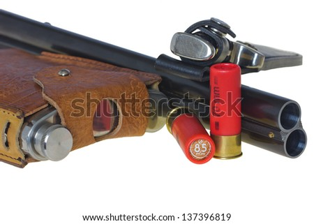 Double shotgun, knif, flask and red cartridges. A rest on a white background - stock photo