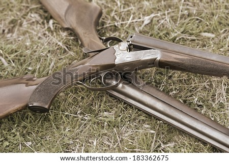 Double shotguns and cartridges  - stock photo
