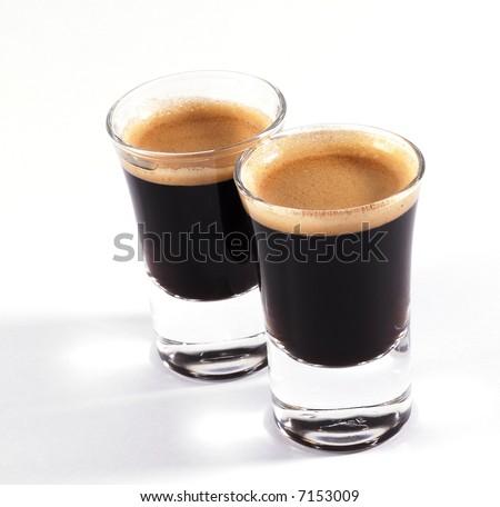 double shots of espresso on classy shot glasses - stock photo