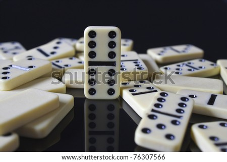 double six domino standing tall over rest - stock photo