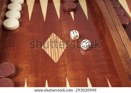 double six or boxcars, rolling dice on backgammon board game                           - stock photo