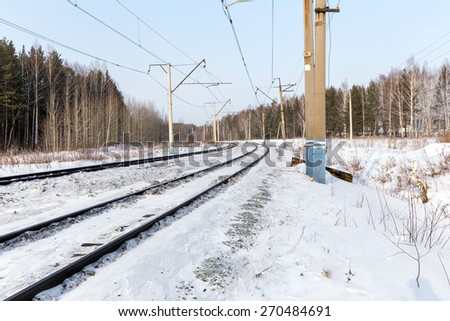 Double-track railway in the winter - stock photo