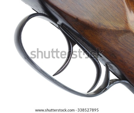 Double triggers that are on an old shotgun isolated on white - stock photo