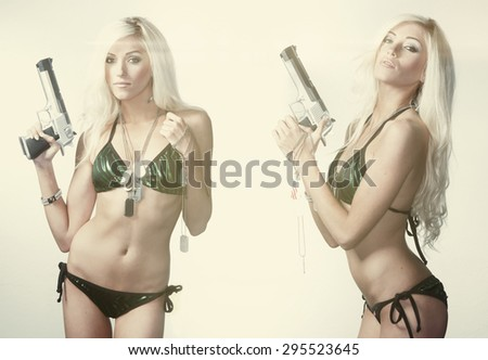 Double trouble, sexy woman holding gun - stock photo