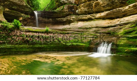 Double waterfall at the and of LaSalle canyon in Starved Rock State Park, Illinois. - stock photo