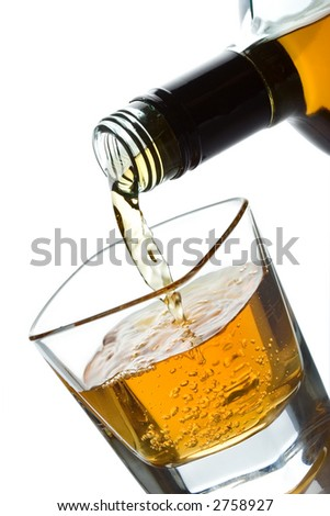 Double whiskey being poured into a glass - stock photo