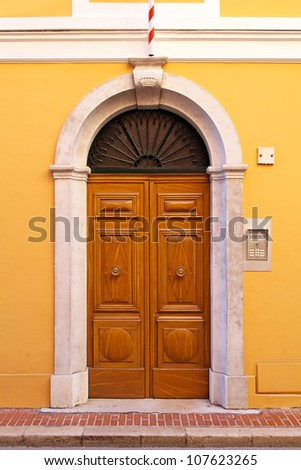 Double wooden door with stone arch at luxury house