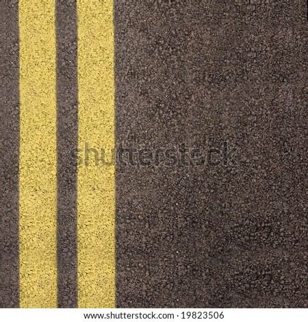 Double yellow line on asphalt texture - stock photo