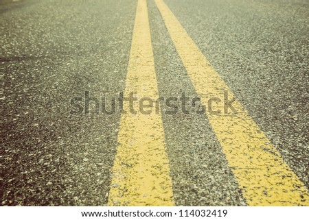 Double Yellow Lines on asphalt - stock photo