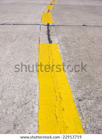 Double yellow lines on road at day