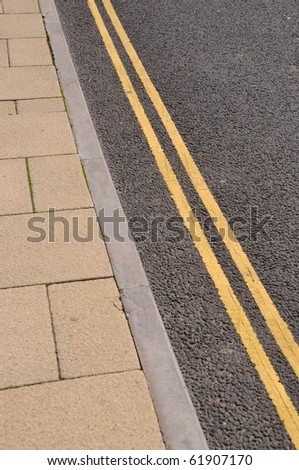 double yellow lines on the asphalt road (forbidden parking) - stock photo
