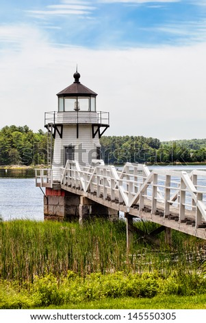 Doubling Point lighthouse in Maine was built in 1898 and is on the National Register of Historic Places. Vertical with copy space. - stock photo
