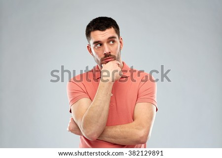 doubt, expression and people concept - man thinking over gray background - stock photo
