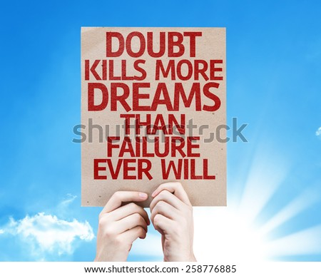 Doubt Kills More Dreams Than Failure Ever Will card with sky background - stock photo
