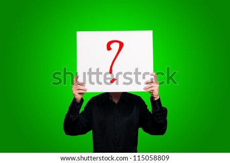 doubt question mark on green background - stock photo