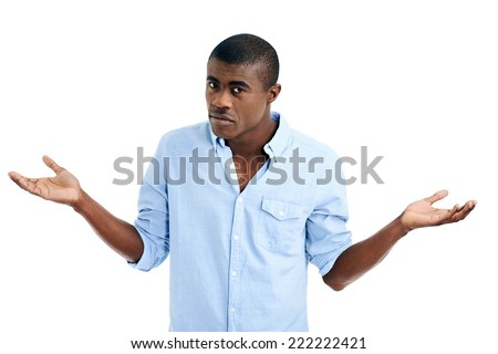 doubtful african man shrugs shoulders with confusion - stock photo