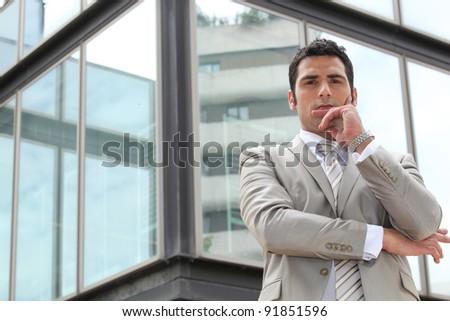 Doubtful businessman - stock photo