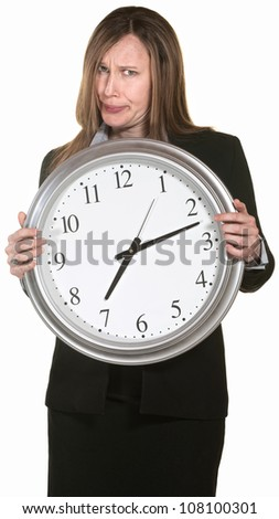 Doubtful businesswoman holding clock isolated over white