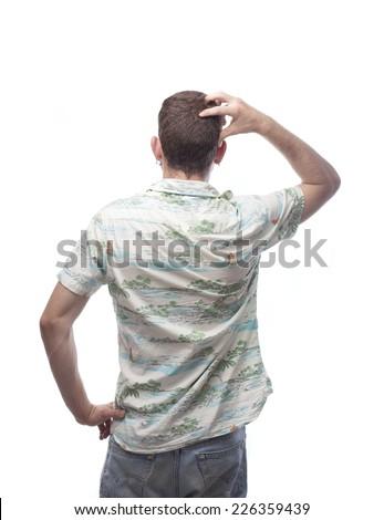 doubtful ginger young man with hawaiian shirt - stock photo