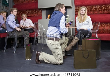 Doubtful reaction on an engagement proposition - stock photo