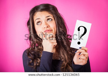 Doubtful Woman holding Question Mark - stock photo