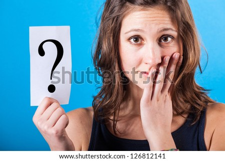 Doubtful Woman with a Question Mark - stock photo