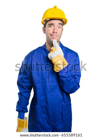 Doubtful workman on white background