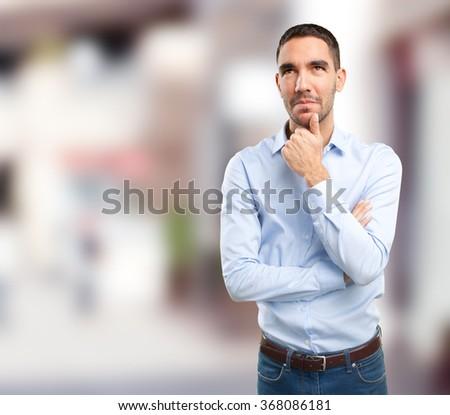 Doubtful young man - stock photo