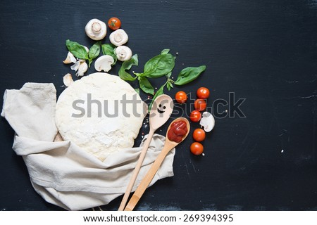 Dough and ingredients for pizza - stock photo