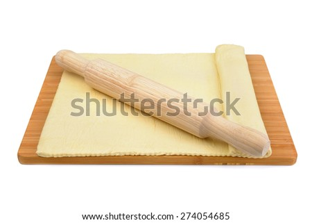 dough and rolling pin isolated on white background - stock photo
