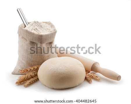 Dough, flour and rolling pin isolated on white background.