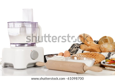 Dough in a food processor, ingredients, type of breads and pies. Studio shot. White background. Copy space.