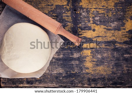 Dough on aged wooden background.
