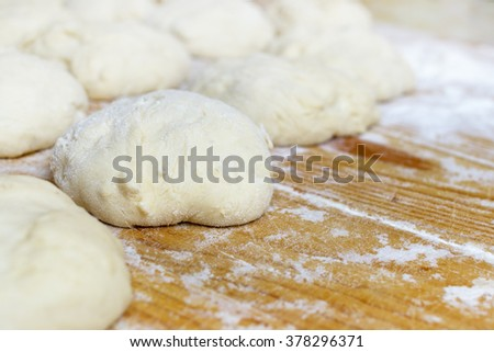 Dough on the wooden board