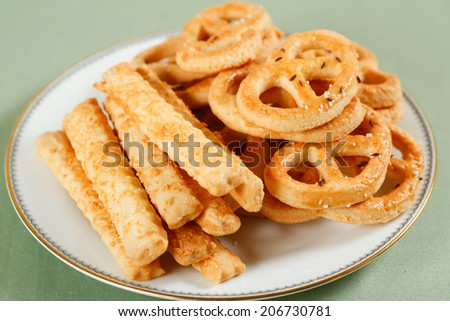 Dough pretzels and crackers - stock photo