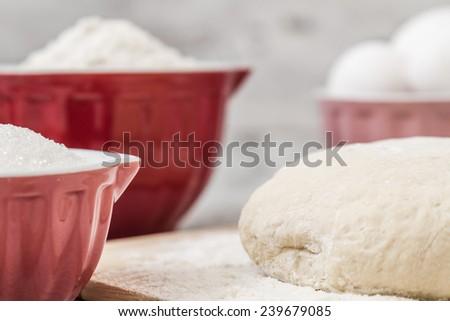 Dough recipe ingredients like eggs, flour, oil, sugar on white wooden table - stock photo