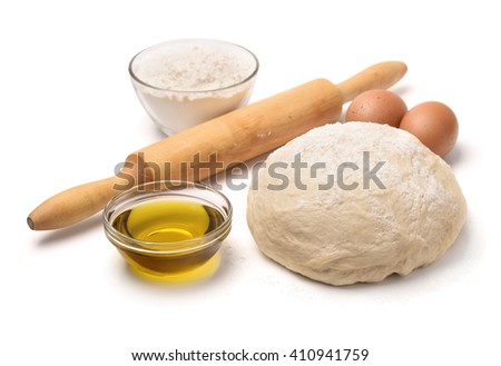 Dough with flour, olive oil, eggs and rolling pin isolated on white - stock photo