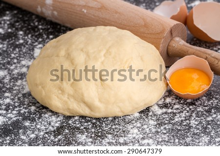 dough with rolling pin and egg