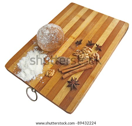 Dough with the sticks of cinnamon on a wooden board. Preparation to Christmas