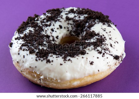 doughnut with cacao on violet table - stock photo