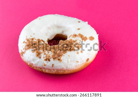 doughnut with sweet crispy on pink table - stock photo