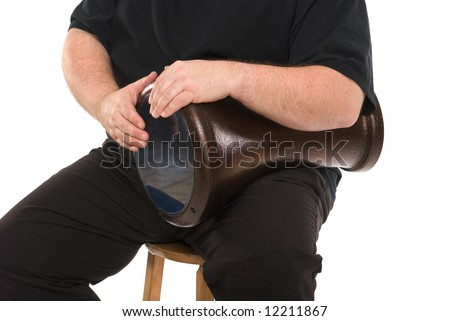 Doumbek (arabic goblet drum) in playing position with hands; isolated on white; unsharpened from raw