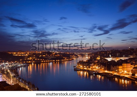 Douro river between cities of Porto and Vila Nova de Gaia in Portugal at dusk. - stock photo