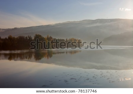 douro river in the fog, at the Regua, Portugal - stock photo