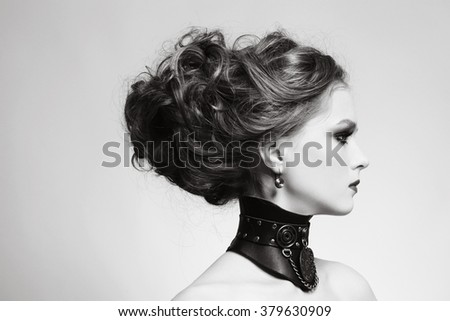 Doutone portrait of young beautiful girl with stylish hairdo and fancy steampunk collar - stock photo