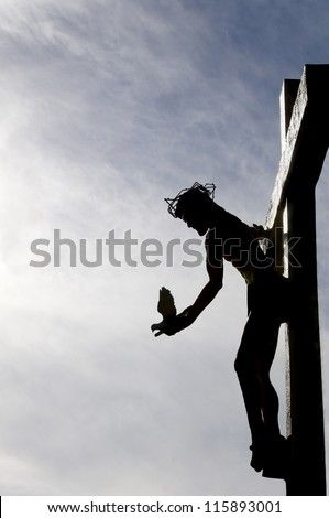 Dove of peace being released by Jesus as he hangs on the cross. - stock photo