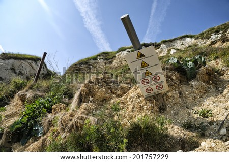 Dover chalk cliffs coastal erosion - fallen warning sign - stock photo