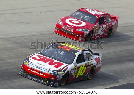 DOVER, DE - SEP 26:  Greg Biffle and Juan Pablo Montoya fight for position during the AAA 400 race at the Dover International Speedway in Dover, DE on Sep 26, 2010. - stock photo
