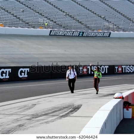 DOVER, DE - SEPTEMBER 25: Danica Patrick walks on pit road to car for qualifying for the NASCAR Nationwide Series race on Saturday, September 25, 2010 in Dover, DE. - stock photo