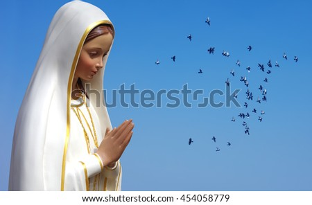 Doves carried the souls of deceased people to heaven - stock photo
